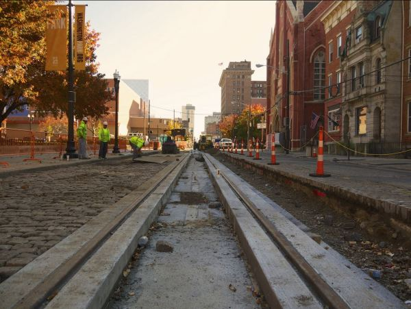 Recently laid Cincinnati streetcar trackage in Elm St. on Nov. 8th. Original granite pavers are being reinstalled to restore historic appearance. Photo: Travis Estell (Flickr).