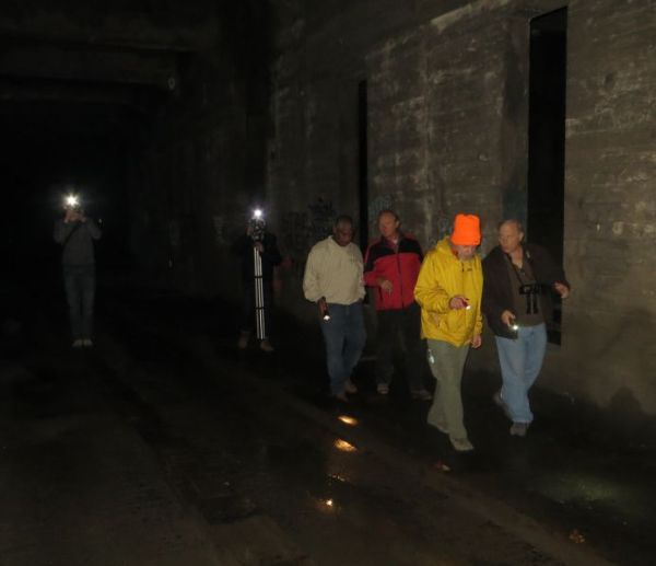 APTA tour group walking through darkness of Cincinnati's never-finished subway on morning of Dec. 14th. (Photo: L. Henry.)