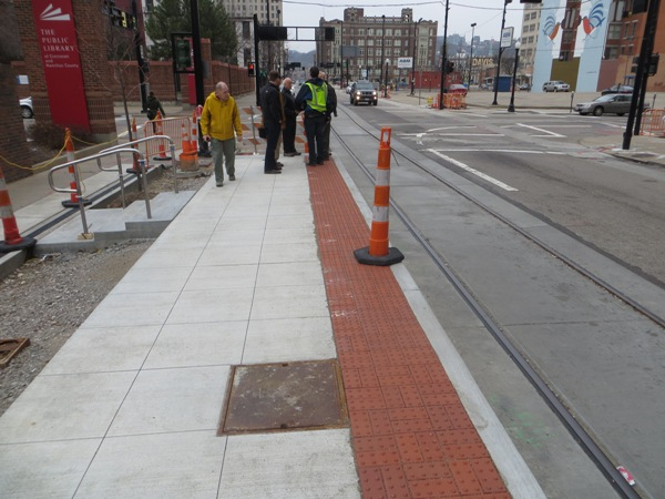 Members of APTA Streetcar Committee inspect streetcar station-stop under construction on Walnut St. in Cincinnati CBD. Photo: L. Henry.