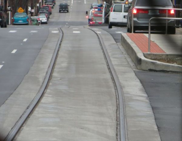 Completed section of streetcar track veers slightly toward station platform. Photo: L. Henry.