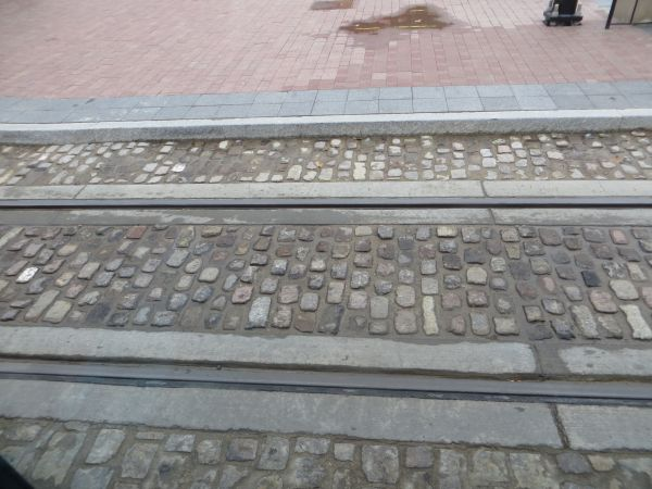 Section of streetcar track embedded in cobblestone paving. Photo: L. Henry.