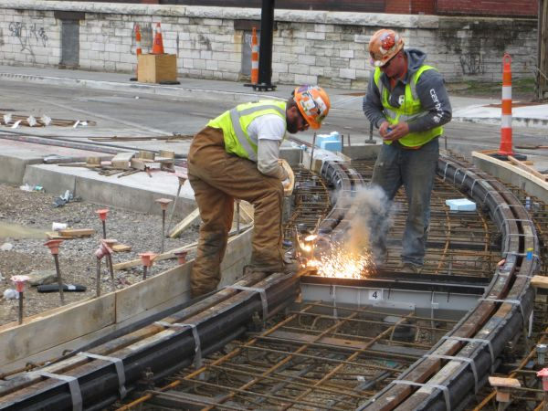 Workers performing thermal weld on track leading into carbarn storage yard. Photo: L. Henry.
